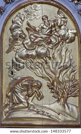 VIENNA - JULY 27: Relief of Moses and burning bush from tabernacle of side altar in church Maria Treu from 18. cent.  on July 27, 2013 Vienna.  - stock photo