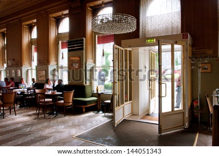 VIENNA - JUNE 5: Entrance to the old cafe Westend in typical Viennese style with historical chairs and couches directly to the opposite of Westbahnhof station on June 5, 2013 in Vienna, Austria - stock photo