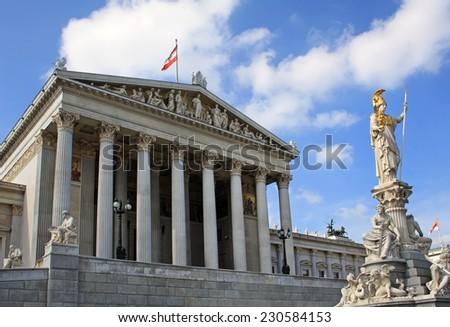 Vienna Parliament building with Athena fountain - stock photo