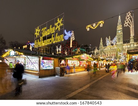 Vienna Town Hall and the traditional Christmas  Market at night - stock photo