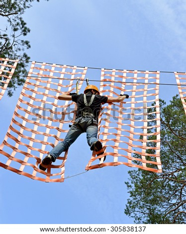 VIERUMAKI,FINLAND - JULY 18,2015:Flowpark is adventure theme park. It is targeted at people older than 6 who have adventurous streak, guaranteed to offer fun challenges to newbies and old hands alike - stock photo