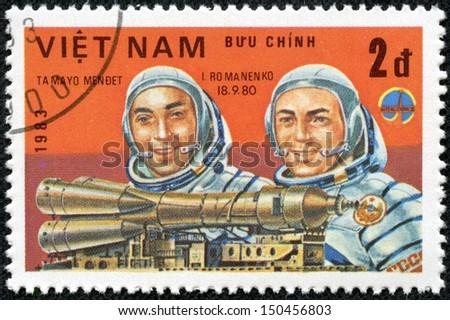VIET NAM - CIRCA 1983: stamp printed by Viet Nam, shows astronauts Mendez, Romanenko, circa 1983 - stock photo