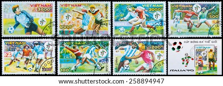 VIETNAM - CIRCA 1990: A stamp printed by Vietnam shows football players. World football cup in Italy, circa 1990 - stock photo