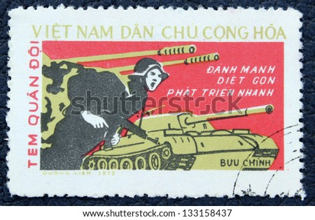 VIETNAM - CIRCA 1972: A stamp printed in the Vietnam, shows attacking troops during the Vietnam War, circa 1972 - stock photo