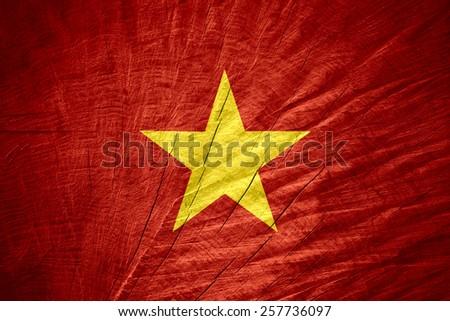 Vietnam flag or Vietnamese banner on wooden texture - stock photo
