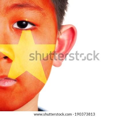 Vietnam flag painted on an Asian boy  - stock photo
