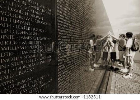Vietnam veterans memorial (shallow DOF, people out of focus) - stock photo