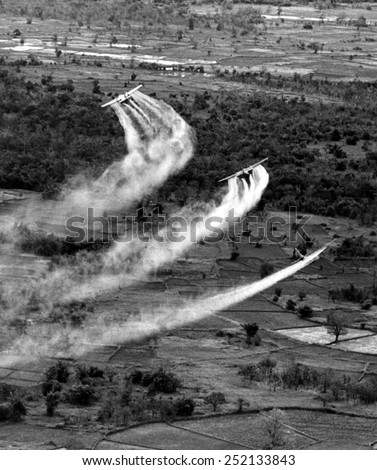 VIETNAM WAR, Crop duster airplanes spray Vietnamese countryside with napalm. photo dated 09/21/66. - stock photo