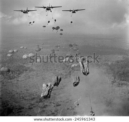 Vietnam War. In March 1963, 840 South Vietnamese paratroopers jump from US Air Force C-123 planes in a strike against Viet Cong in the Tay Ninh Province of South Vietnam. - stock photo