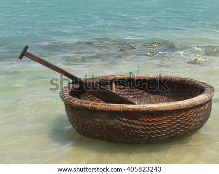 Vietnamese boat like basket near the ocean - stock photo