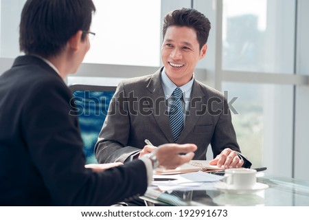 Vietnamese businessman interviewing candidate in the office - stock photo