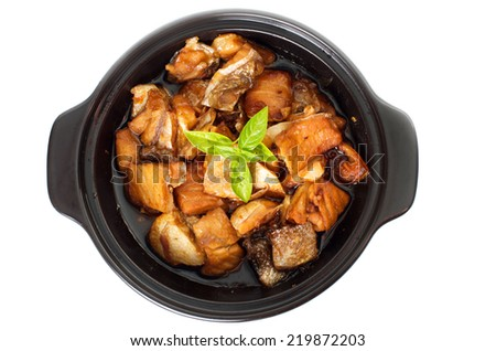 Vietnamese caramelized fish in clay pot - Ca Kho To - top view - stock photo