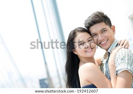 Vietnamese couple hugging - stock photo