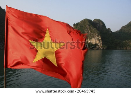 Vietnamese flag in front of Halong Bay background - stock photo