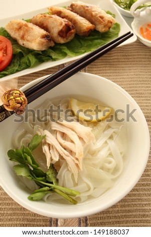 Vietnamese food, chicken Pho and spring roll - stock photo