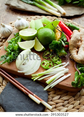 Vietnamese food ingredient board -  ginger, chili, lime, spring onion, garlic, shallots, shiitake mushroom, mint, cilantro, coriander. All colorful spices make traditional asian food more delicious. - stock photo