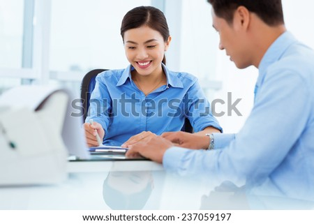 Vietnamese managers discussing business project - stock photo