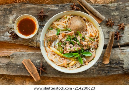 Vietnamese pho on wood table. Pho is a vietnamese traditional food. it's very popular on the world.  - stock photo