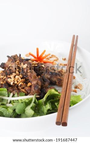 Vietnamese pork skewer on rice vermicelli - stock photo