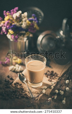 Vietnamese style drip coffee with condense milk, with film filter effect - stock photo