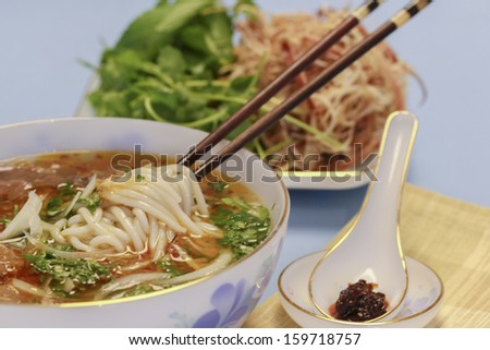 Vietnamese Traditional Food: soup containing rice vermicelli and beef - stock photo