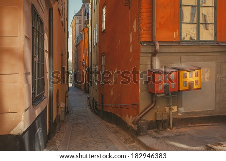 View a narrow street in the Old Town. Stockholm, Sweden. Retro film effect. - stock photo