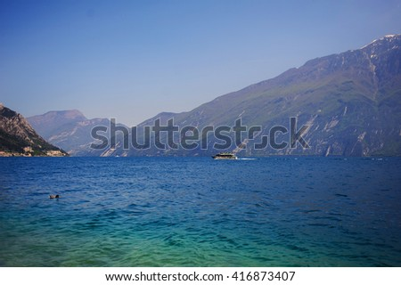 View above big beautiful lake, Garda lake, Italy. Sunny day, place for text. - stock photo