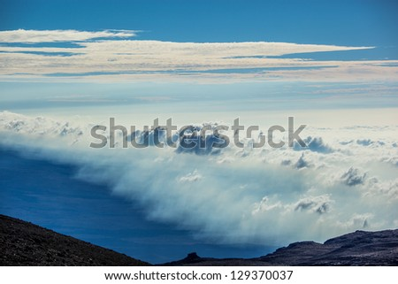 View above clouds from Mauna Kea mountain, Big Island, Hawaii - stock photo