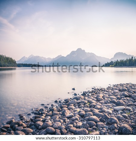 View across Jackson Lake of the Grand Tetons near Moran,  USA., wyoming - stock photo
