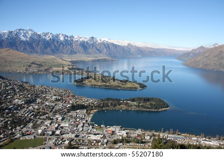 View across Queenstown and Lake Wakatipu to the Remarkables in New Zealand - stock photo
