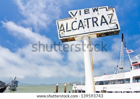 View Alcatraz!  Alcatraz itself is visible at the base of the sign. - stock photo