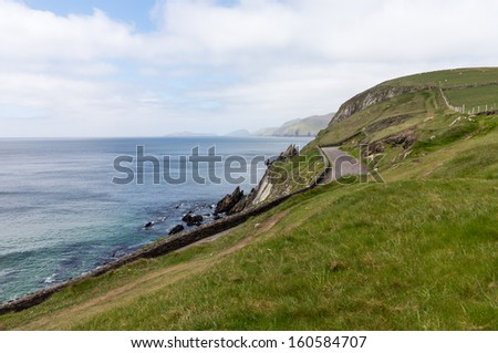 View along the coastline of the western point of County Kerry near Dingle in Ireland or Eire - stock photo