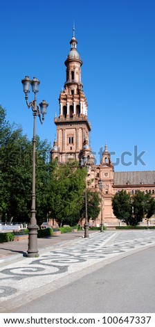 View along the main shopping street with the church to the rear, Torrox, Costa del Sol, Malaga Province, Andalusia, Spain, Western Europe. - stock photo