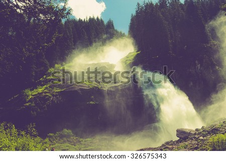 View Alpine inspiring Krimml waterfall in mountains, clear blue sky, deep rich green forest, spruce, trees. Summer. trekking in National park Hohe Tauern, Austria. poster Image instagram filter photo - stock photo