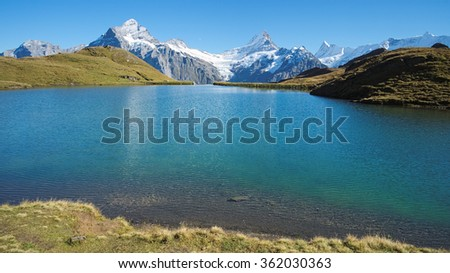 View at Bachalpsee during hike from First towards Grindelwald (Switzerland). The hiking trail is very famous. Great views are enjoyed along the way towards mountains like the Eiger, Monch and Jungfrau - stock photo