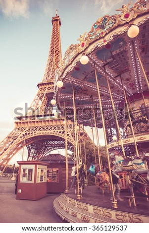 View at Champs de Mars in Paris with Eiffel Tower and carousel with vintage filter effect - stock photo