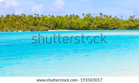 view at picture perfect island, turquoise lagoon at aitutaki, cook islands - stock photo