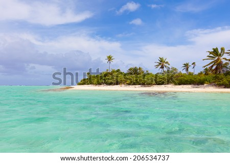 view at the picture perfect island and surrounding lagoon - stock photo