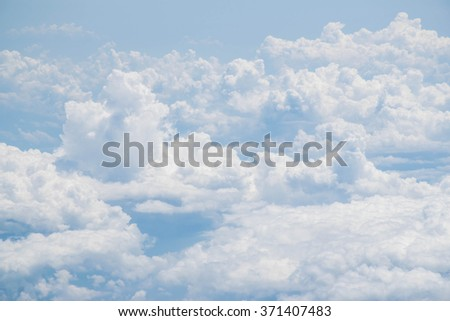 view Clouds and blue sky from airplane window - stock photo