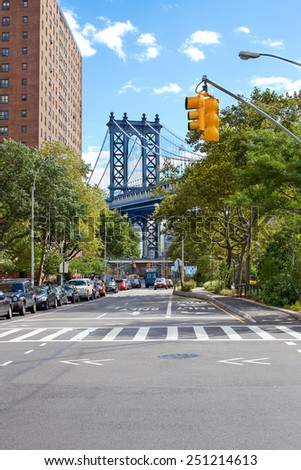View down Pike Street at the Manhattan Bridge in the Lower East Side, New York, NY, USA. - stock photo