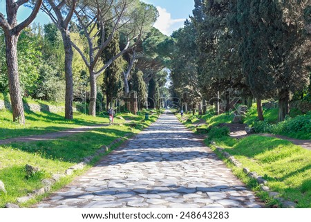 View down the ancient Via Appia Antica in Rome, Italy. - stock photo