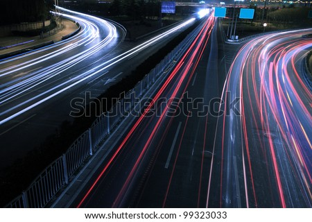 View dusk urban rainbow light  night traffic on the highway skyline - stock photo
