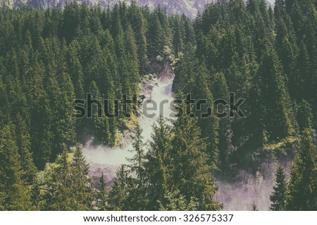 View far, away Alpine inspiring Krimml waterfall in mountains, deep rich green forest, spruce, trees. Summer. trekking in National park Hohe Tauern, Austria. poster Image instagram filter photo - stock photo