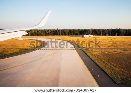 View form the illuminator of airplane when landing or taking off - stock photo