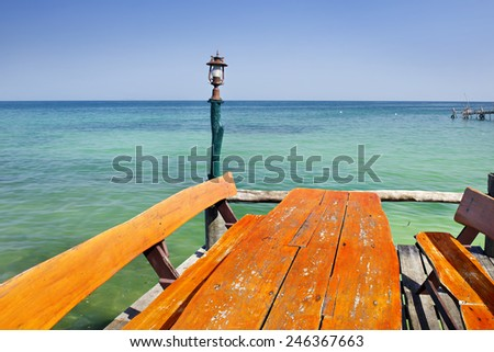 View from a  beach with a picnic table  - stock photo