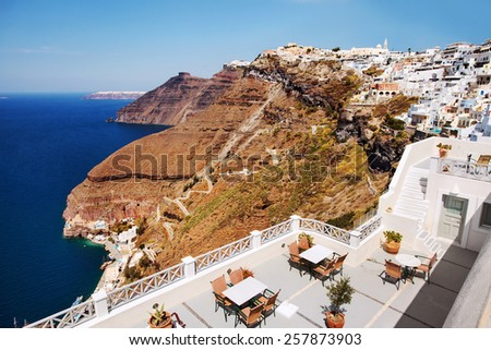 View from a cafe of Fira's famous 587 steps and old town. Santorini Greece - stock photo