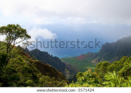 View from a lookout point looking at the ocean and mountains of Kauai, Hawaii - stock photo