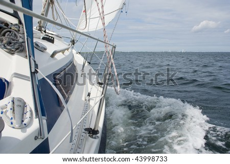 View from a sailing yacht, sailing in a good wind on lake Grevelingen - stock photo