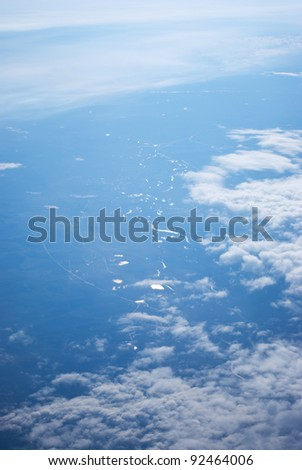 View from above and  plane on earth  in fog - stock photo