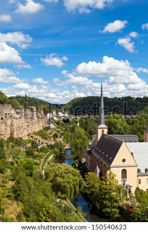 View from above on to the Neumunster Abbey in Luxembourg Grund. The Casemates and the river Alzette flowing in the valley. - stock photo